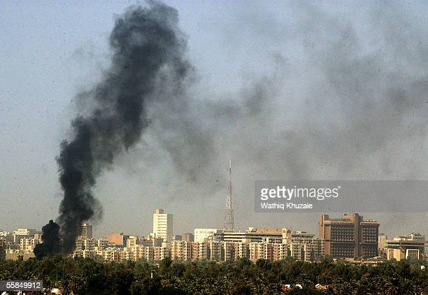 Smoke rises near the heavily fortified Green Zone area after a car bomb explosion October 4, 2005 in Baghdad, Iraq. A suicide car bomb exploded near...