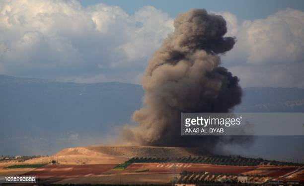 TOPSHOT Smoke rises near the Syrian village of Kafr Ain in the southern countryside of Idlib province after an airstrike on September 7 2018 The...