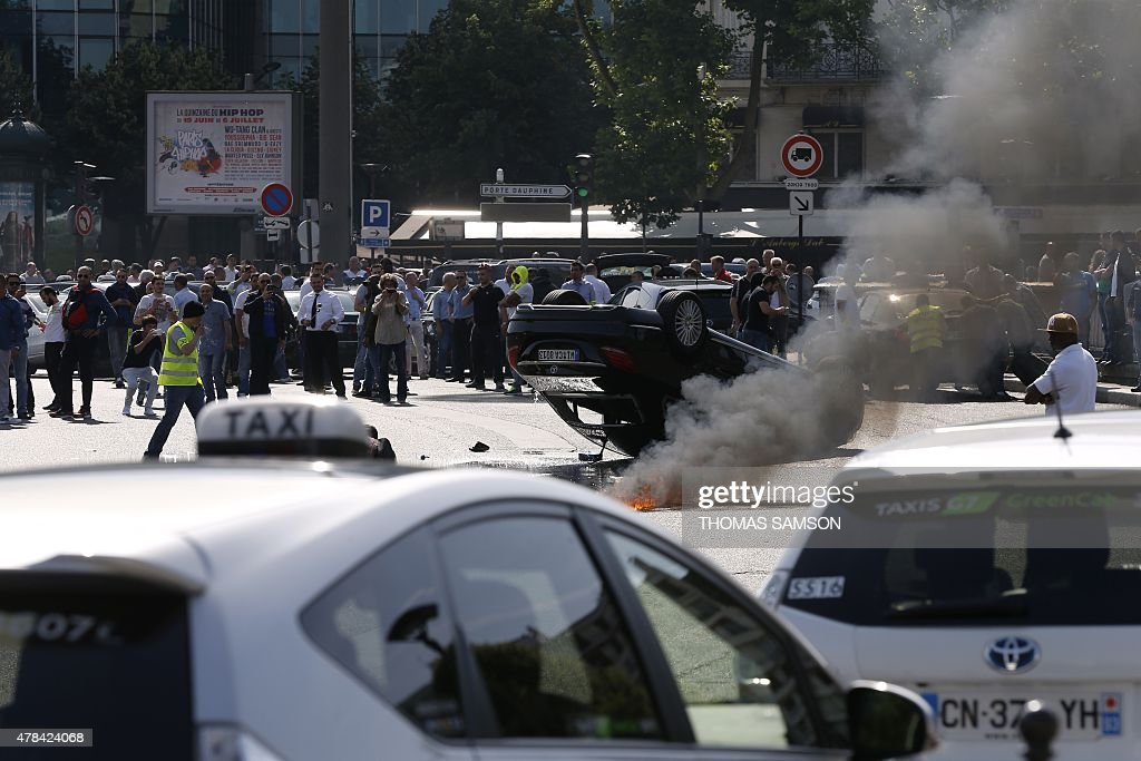 Smoke Rises Next To An Overturned Car As Taxi Drivers Block Porte - Taxi porte maillot