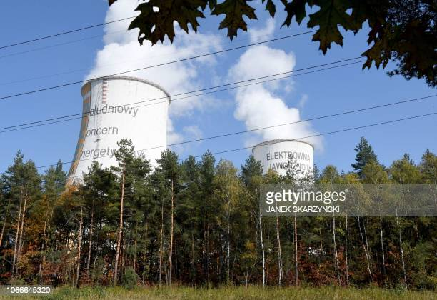 Smoke rises over a power plant on October 12 2018 in Jaworzno in Poland's southern mining region of Silesia In Brussels Berlin and Paris coal is the...