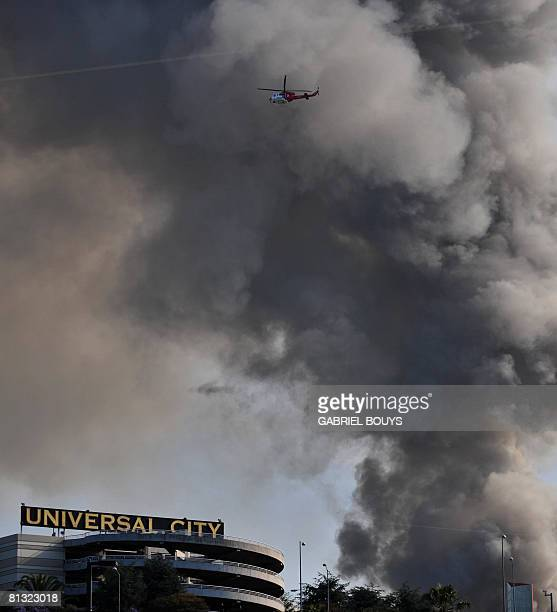 Smoke rises over burning structures at Universal Studios in Universal City California on June 01 2008 More than 100 firefighters were battling a huge...