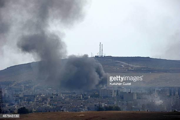 Smoke rises over Syrian town of Kobani after an airstrike October 27 2014 near Mursitpinar border crossing on the TurkishSyrian border Sanliurfa...