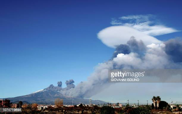 Smoke rises over the city of Catania during an eruption of the Mount Etna one of the most active volcanoes in the world on December 24 2018