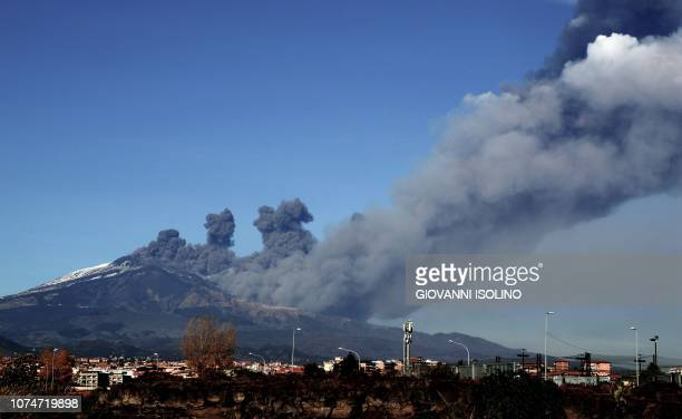 TOPSHOT Smoke rises over the city of Catania during an eruption of the Mount Etna one of the most active volcanoes in the world on December 24 2018