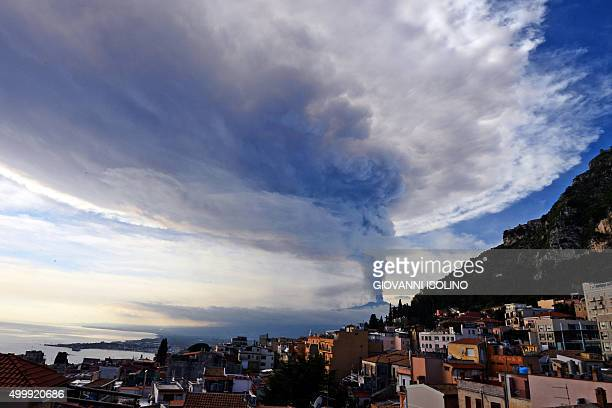 TOPSHOT Smoke rises over the city of Taormina during an eruption of the Mount Etna one of the most active volcanoes in the world near Catania on...