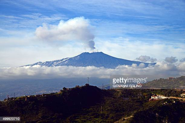 Smoke rises over the city of Taormina during an eruption of the Mount Etna one of the most active volcanoes in the world near Catania on December 4...