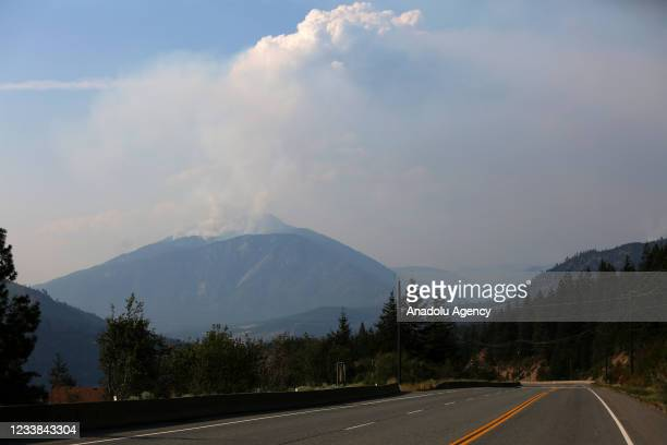 Smoke rises over the mountains in Lytton as firefighters still battle the fires in British Columbia, July 6, 2021.