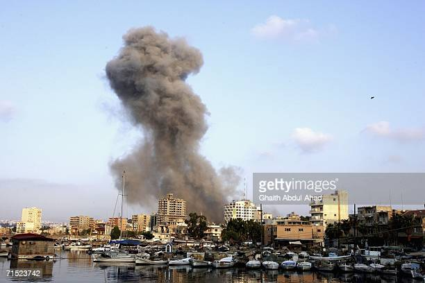 Smoke rises over the port of Tyre after an Israeli air strikehit a cultural centre affiliated with Hezbollah July 26 2006 in the southern Lebanese...