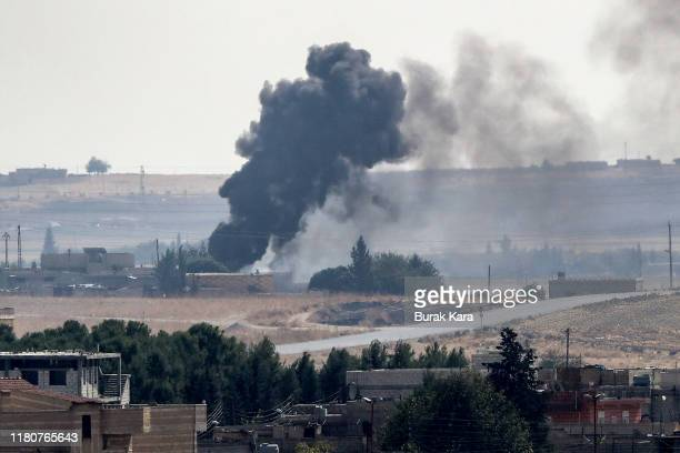 Smoke rises over the Syrian town of Tel Abyad, as seen from the Turkish border town of Akcakale on October 13, 2019 in Akcakale, Turkey. The military...