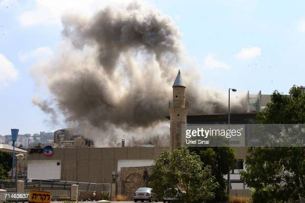 Smoke rises seconds after a Hezbollah missile strike July 17, 2006 in the northern Israeli city of Haifa. At least 12 Israeli civilians have been...