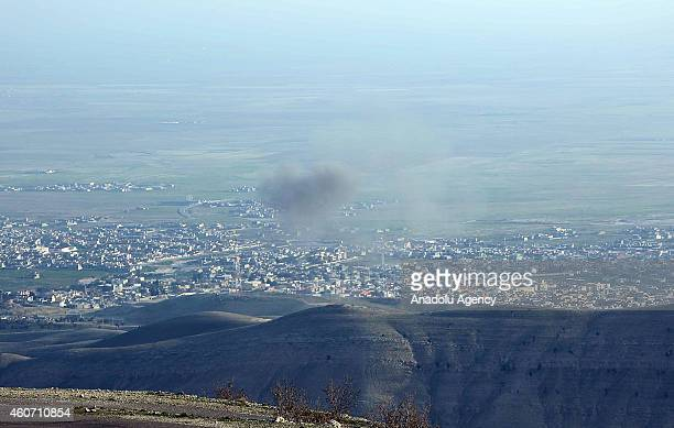 Smoke rises when peshmerga fighters departed from the Zommar district of Mosul fight against Islamic State of Iraq and Levant at Sinjar Mountains in...