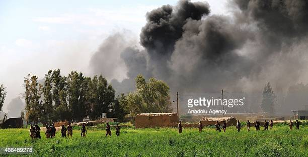 Smoke rises when peshmergas stage an operation against Daesh militants in the village of Vahde in Dakuka district on March 162015