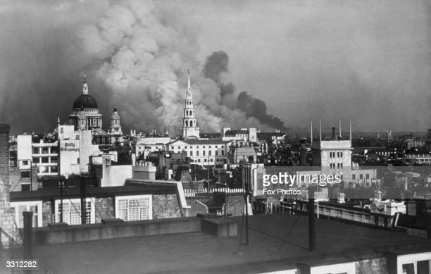 Smoke rising behind StPaul's Cathedral during the Blitz