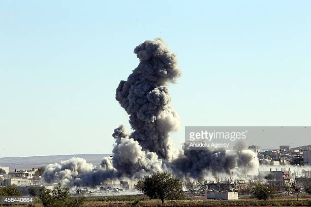 Smoke rising during the clashes between Islamic State of Iraq and Levant members and armed groups in Ayn al Arab is seen from Suruc district of...