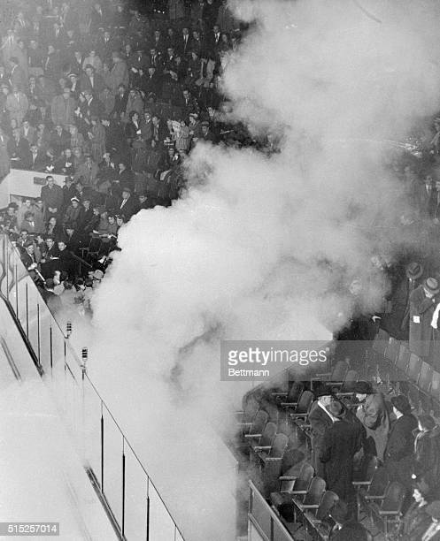 Smoke rising from a tear gas bomb drifts through the Forum arena March 17 as 15 000 demonstrators angrily protest the suspension of Maurice The...