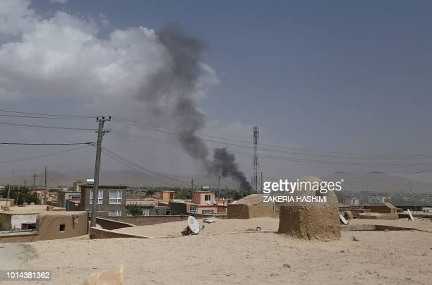Smoke rising into the air after Taliban militants launched an attack on the Afghan provincial capital of Ghazni on August 10, 2018. - US forces...