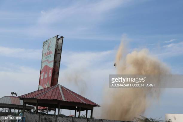 Smoke rising over SYL hotel in Mogadishu after security forces detonated unexploded device in Mogadishu on December 11, 2019. - An attack by members...