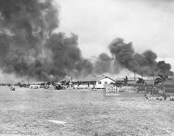 Smoke roils over Pearl Harbor and the officer's quarters at Hickam Field during the Japanese attack on December 7 1941