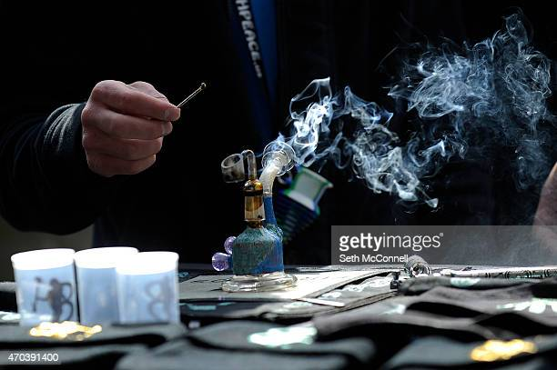 Smoke rolls off the end of a dab rig during the High Times Cannabis Cup at the Denver Mart in Denver Colorado on April 19 2015 The High Times...