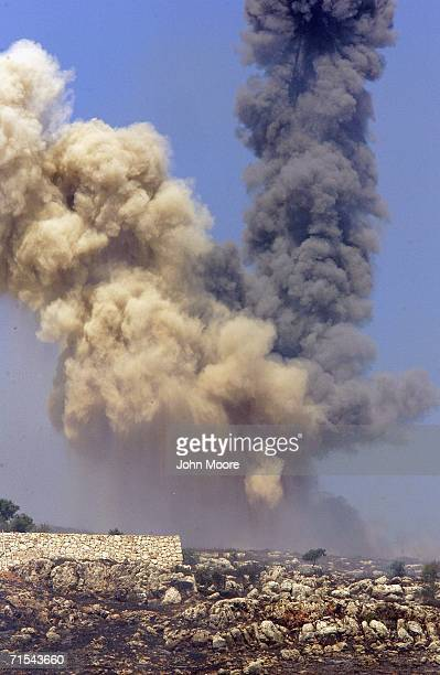 Smoke shoots into the sky after an Israeli airstrike in southern Lebanon on July 31, 2006 near the Israel Lebanon border. Israeli troops crossed into...