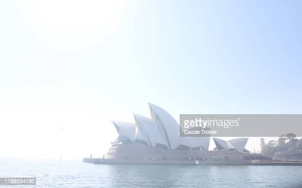 Smoke shrouds the Sydney Opera House on November 19 2019 in Sydney Australia NSW remains under severe or very high fire danger warnings as more than...
