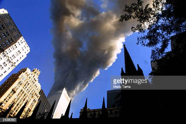 Smoke spews from a tower of the World Trade Center September 11 2001 after two hijacked airplanes hit the twin towers in a terrorist attack on New...