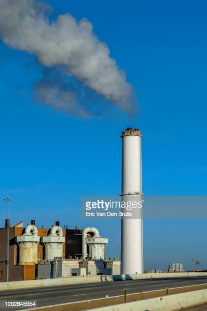 smoke stack air pollution - eric van den brulle stock pictures, royalty-free photos & images