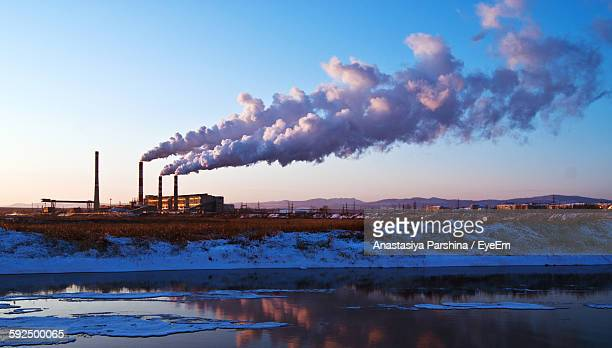 Smoke Stack Emitting Pollution In Sky