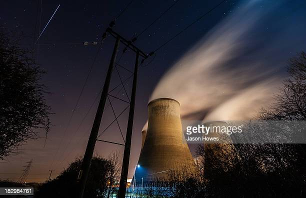CONTENT] smoke stacks and a passing meteor at the now defunct Didcot power station UK
