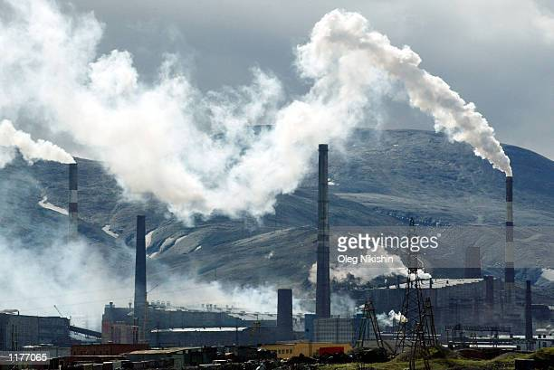 Smoke stacks for a nickel-refinery spew sulfur dioxide into the environment July 21, 2002 in Norilsk, Russia. The refinery releases some 2.8 million...