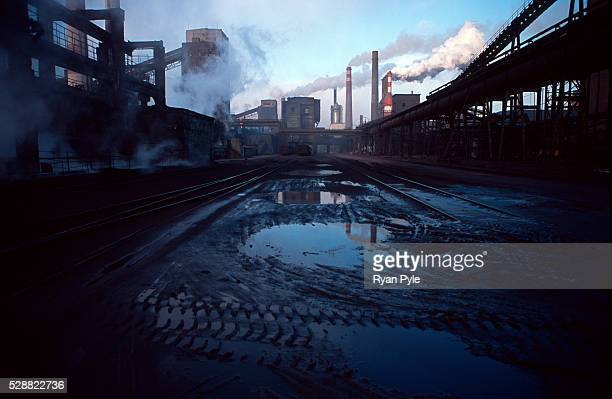 Smoke stacks in the Bao steel mill in Baotou, Inner Mongolia, China. Baotou is an excellent example of a one-industry town, and that industry is...