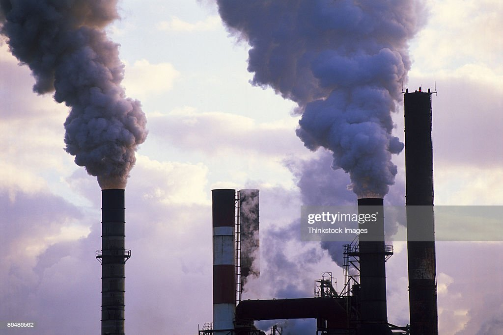 Smoke stacks of factory : Stock Photo
