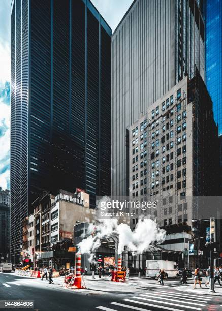 smoke stacks on the streets of new york, lower manhattan - busy sidewalk stock pictures, royalty-free photos & images