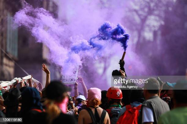 A smoke torch is seen during a protest on the International Women's Day in Mexico City Mexico on March 8 2020