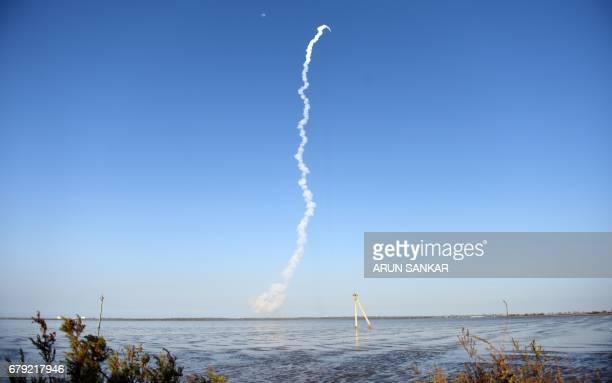 Smoke trails are seen as The Indian Space Research Organisation's GSAT9 on board the Geosynchronous Satellite Launch Vehicle launches from...