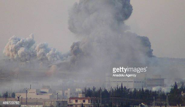 Smoke trails over after the alNusra Front stages a suicide bomb attack in Nubul And Zahra villages Aleppo Syria on November 292014