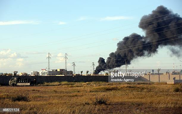 Smoke trails over as Iraqi security forces and Shiite militas attack against Daesh in Tikrit Iraq on March 31 2015