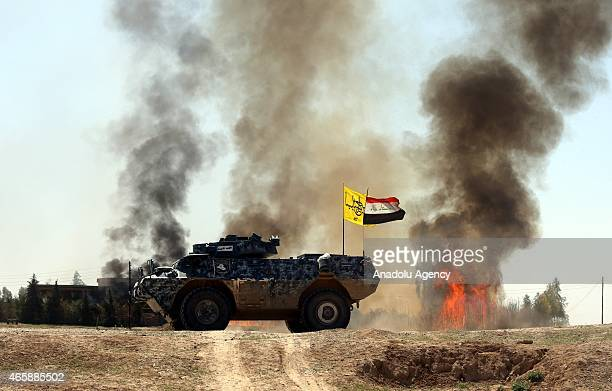Smoke trails over during clashes between Iraqi army forces supported by Shiite militias and Daesh in Tikrit Iraq on March 11 2015