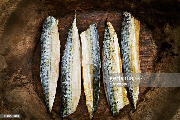 smoked fish fillets laid out in a row. - mackerel stock pictures, royalty-free photos & images
