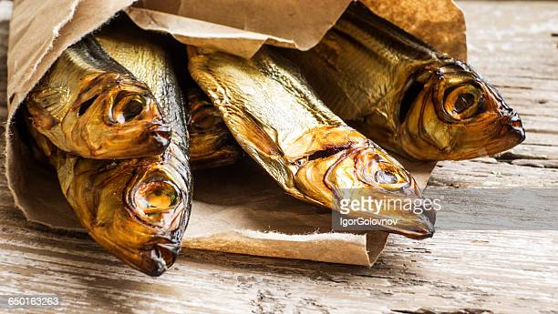 Smoked herring fish wrapped in brown paper