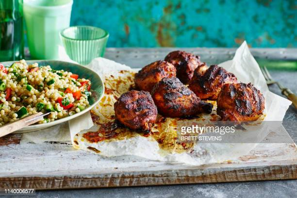 smoked paprika chicken legs, pearl couscous - paprika stock pictures, royalty-free photos & images