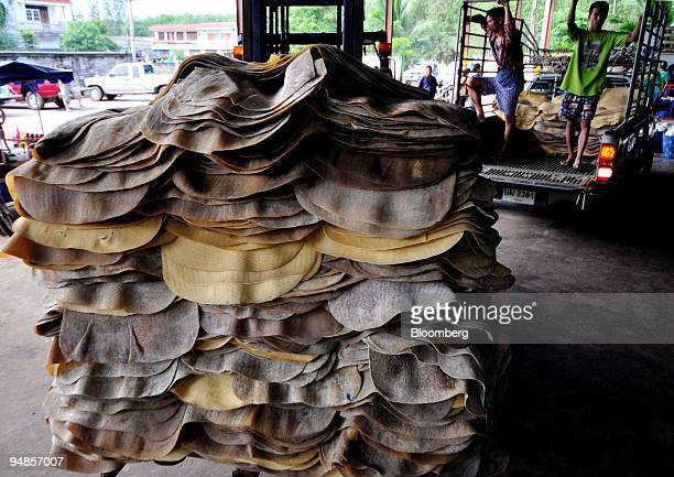 Smoked ribbed rubber sheets are delivered to a rubber dealer in Samnak Thong Rayong province Thailand on Wednesday Nov 5 2008 Natural rubber advanced...
