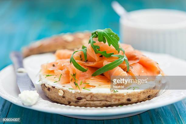 smoked salmon bagel - smoked food stock photos and pictures