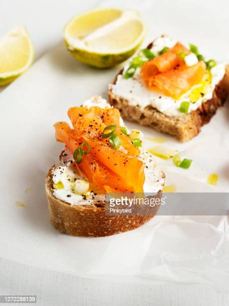 smoked salmon bread, bruschetta with salmon,  salmon sandwich, tartines - ready to eat stock pictures, royalty-free photos & images