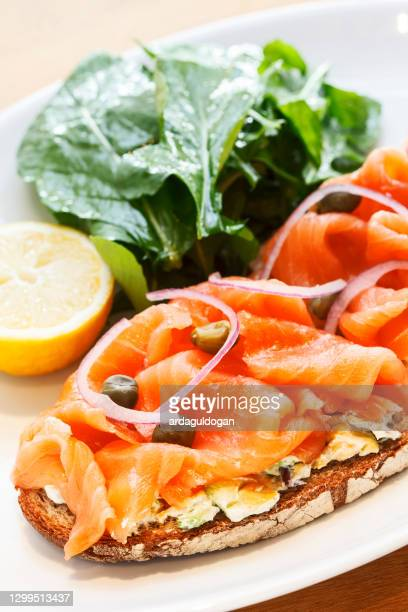 smoked salmon bruschetta - fatty acid stock pictures, royalty-free photos & images