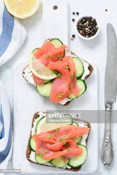 Smoked salmon, cream cheese and cucumber toast sandwiches on white
