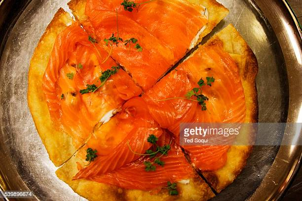 Smoked Salmon Pizza with Dill Creme Friache and Caviar is displayed on a serving tray Master chef Wolfgang Puck creates the dishes that will be...