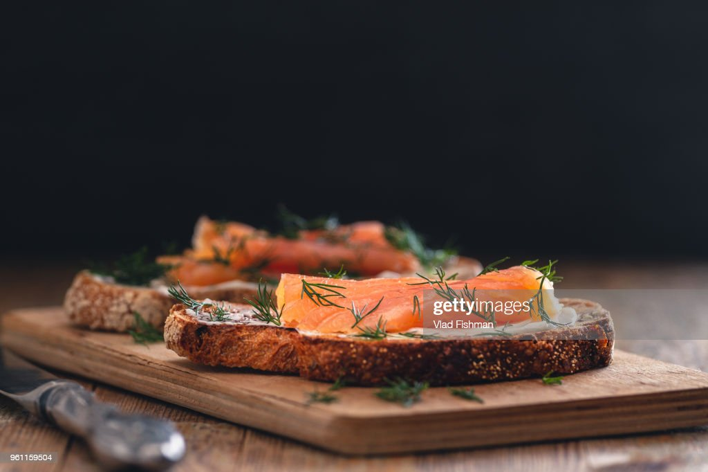 Smoked salmon sandwich appetizer with toasted bread : Stock Photo