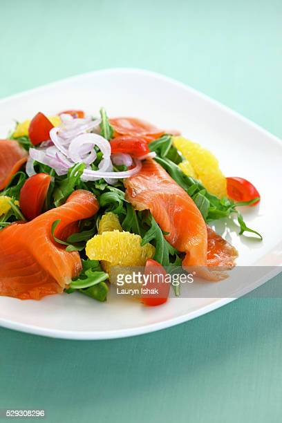 Smoked salmon with Arugula, dressed with onions, tomatoes and oranges