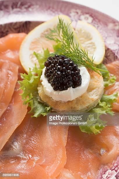 smoked salmon with caviar and sour cream canap?? - canap�� photos et images de collection